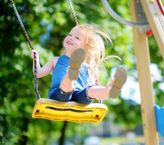litle girl on swing / playground